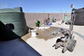 In previous rodeos, teams competed in simulations that included a tornado-damaged nuclear reactor scenario. Operators were tasked with quickly locating and moving simulated fuel rods, stopping the flow of radioactive water from running into a storm drain system and minimizing radioactive contamination on the robot.
