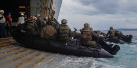 Marines and sailors aboard the amphibious assault ship USS New Orleans execute small boat drills in the Philippine Sea. Greater integration between the Navy and Marine Corps is leading to more joint operations in support of maritime security. Credit: Lance Cpl. Grace Gerlach, USMC