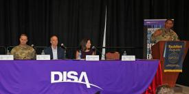 A DISA panel discusses how the agency is delivering capabilities to warfighters at AFCEA TechNet Augusta. Photo by Michael Carpenter