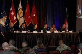 Maj. Gen. John Morrison Jr., USA, commanding general of the Army Cyber Center of Excellence (far r), moderates a panel at the AFCEA TechNet Augusta conference. Photo by Michael Carpenter