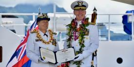 The U.S. Coast Guard is facing additional challenges, especially in the Pacific, says Vice Adm. Linda Fagan (l), USCG, Coast Guard Pacific Area commander, pictured presenting Rear Adm. Kevin Lunday, commander, Coast Guard 14th District, with a Legion of Merit award during a ceremony on the U.S. Coast Guard Base Honolulu, Hawaii, in June 2020. Credit: U.S. Coast Guard photo by Chief Petty Officer Sara Muir