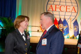 Vice Adm. Nancy Norton, USN, pictured with AFCEA President and CEO Lt. Gen. Robert M. Shea, USMC (Ret.), at DCOS, looks to the National Background Information System to advance the country¹s efforts in federal background investigations. Credit: Mike Carpenter