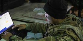 Warrant Officer Alan Mendoza, USA, an all-source intelligence technician assigned to the 2nd Battalion, 34th Armored Regiment, 1st Armored Brigade Combat Team, reviews significant activity during exercise Allied Spirit X in Hohenfels, Germany. The exercise included participants from 15 nations, enabling U.S. military participants to evaluate communications interoperability. (Photo Credit: Sgt. Thomas Mort, USA)