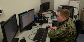 A U.S. Navy information systems technician works on a computer in a Carrier Vessel Nuclear Information Technology space. The Navy is incorporating the mechanism in its new information systems contract to provide capability upgrades on the fly. Photo Credit: U.S. Navy
