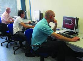 Students peer at computer screens as part of a COE DAT course in cyberspace attacks. As cyberspace becomes a more useful tool for terrorists, the COE DAT is increasing its work to identify how terrorists use it and to inform alliance partners on these new aspects.