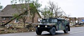 Members of the Oklahoma National Guard drive down Telephone Road in Moore, Oklahoma, May 21, 2013, en route to the neighborhoods devastated by a tornado. Cybersecurity needs to be a priority in the aftermath of major disasters when people and their personal data can be most vulnerable. U.S. Air Force photo by Senior Airman Mark Hyber