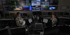 Two U.S. Air Force space and cyber airmen work in the Global Strategic Warning and Space Surveillance Systems Center at Cheyenne Mountain Air Force Station, Colorado. The Air Force aims to change the nature of its cyber work force as it transitions deeper into the information age.