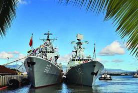The People's Liberation Army Navy (PLAN) Luhu-class destroyer Qingdao (l) and the Jiangkai-class frigate Linyi are moored at a dock while visiting Joint Base Pearl Harbor-Hickham in Hawaii in September. The newest PLAN destroyer, an 052D model, incorporates lessons learned from these ships alongside innovative technologies.