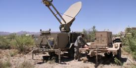 A U.S. Army soldier works with a power unit supplying a satellite antenna during an exercise. Military and civilian governments increasingly will benefit from future satellite network systems that are smaller, lighter and simpler and use less power.