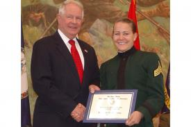 Lt. Gen. John A. Dubia, USA (Ret.), former executive vice president of AFCEA International, presents Kimberly Nicole Denny of Jacksonville, Florida, the first AFCEA Lt. Gen. John A. Dubia, USA (Ret.), Scholarship in November 2014. Cadet Denny is a junior at Mary Baldwin College in Staunton, Virginia, and participates in the ROTC program at nearby Virginia Military Institute, Lexington, Virginia.