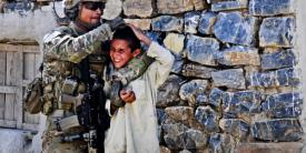 A U.S. Army soldier gives a playful head rub to a to a local boy while on patrol near Forward Operating Base Salerno in Afghanistan. Human intuition may one day help artificial intelligence distinguish between safe and dangerous scenarios.