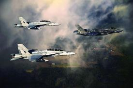 A U.S. Marine Corps F-35 aircraft is escorted by two Marine F/A-18 Hornets as it flies toward Eglin Air Force Base, Florida. Later this year, the Defense Department will establish a program of record to ensure communications between different generations of fighter aircraft, and that program will feed into the Joint Aerial Layer Network vision.