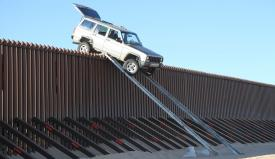 Smugglers used a makeshift ramp to attempt to drive over a border fence in 2012 but fled when the truck didn't make it over. Jeh Johnson, secretary of the Homeland Security Department, is calling for a 2015 appropriations bill to fund more technology to help secure the southern border.