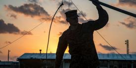 Cpl. Jacob Worshan, USMC, holds an antenna during a long distance, high frequency communications training event held on Camp Schwab, Okinawa, Japan. This training between 1st and 3rd Marine Division helps the units maintain a low electromagnetic signature that is virtually impervious to jamming and interference, which allows for distributed operations without detection in the operating environment.  Photo by Lance Cpl. Christian Ayers, USMC