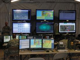A tactical operations center monitors an NIE. Securing cyber capabilities, starting in the laboratory then extending to the field, is a priority for the U.S. Army.