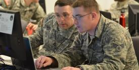 Two Vermont Army National Guard computer network defense team members participate in a 2014 Cyber Shield exercise. The command and control of defensive cyber operations now is centralized in the Defense Department's Joint Force Headquarters (JFHQ) Department of Defense Information Network (DODIN).
