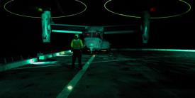 An aviation support equipment technician directs an MV-22B Osprey on the deck of the USS San Diego in the South China Sea. Operations in the vast Indo-Asia-Pacific region are increasing in complexity concurrent with rising challenges.