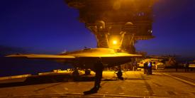 An X-47B unmanned aircraft undergoes nighttime testing aboard the USS Theodore Roosevelt. Better integration of platforms and sensors is one goal of the U.S. Navy's Program Executive Office (PEO) for Unmanned Aviation and Strike Weapons.