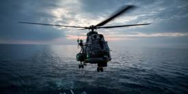 A Romanian navy helicopter prepares to land on the deck of a frigate during maneuvers by Standing NATO Maritime Group 2 in the Black Sea. The NATO Communications and Information (NCI) Agency is looking toward industry to equip its military and organizational forces with proven technologies that enhance mobile links.