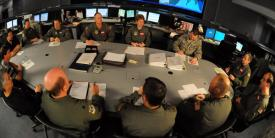 Personnel with the 618th Tanker Airlift Control Center coordinate global operations from Scott Air Force Base, Illinois. The U.S. Transportation Command (TRANSCOM) finds itself amid battles in cyberspace as intrusions on networks owned by its commercial partners pose a significant threat to U.S. military operations.