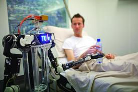 Researchers working on the RoboEarth project demonstrate a robot's ability to learn and cooperate with other robotic systems to serve medical patients. The project uses cloud computing to teach robots to perform tasks that seem intuitive for humans but are a challenge for robots.