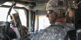 Command Sgt. Maj. Alan Hummel, USA, senior enlisted adviser for the 4th Infantry Brigade Combat Team, 3rd Infantry Division, uses a Joint Battle Command-Platform system to navigate to his unit's training on the Blue Force Tracking technology.
