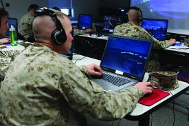 U.S. Marines communicate digitally over a network. The Next Generation Enterprise Network, or NGEN, will take a new approach to networking yet evolve from the existing Navy Marine Corps Intranet.