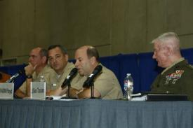 (r-l) Lt. Gen. John Toolan, USMC, commanding general, I Marine Expeditionary Force; Vice Adm. Kenneth E. Floyd, USN, commander, Third Fleet; Vice Adm. Thomas H. Copeman III, USN, commander, Naval Surface Forces; and Vice Adm. David H. Buss, USN, commander, Naval Air Forces, discuss naval strategy.
