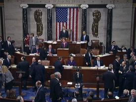 U.S. House of Representative members await on the flood for the final tally of a vote Friday on DHS funding.