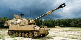 """M109A6 Paladin self-propelled howitzers from Battery B, 1st Battalion, 9th Field Artillery Regiment """"Battlekings,"""" 2nd Armored Brigade Combat Team, 3rd Infantry Division, sit ready to fire at Fort Stewart, Georgia, September 11, 2014. Credit: U.S. Army/Staff Sgt. Richard Wrigley"""