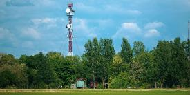 A communications tower for military 5G rises above a forest. Several challenges loom as the U.S. Defense Department strives to implement 5G into the force. Credit: M.Moira/Shutterstock