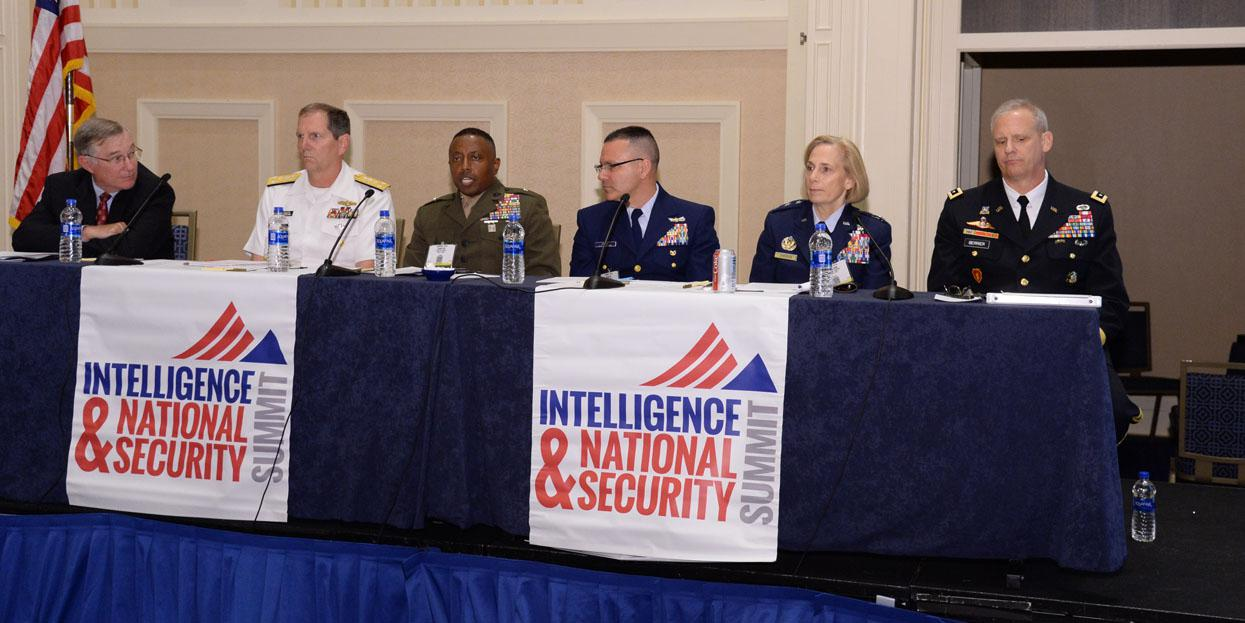 """A row of service intelligence chiefs describes today's threats and needed solutions in a panel chaired by (far l) Vice Adm. Jake Jacoby, USN (Ret.). The panelists are (l-r) Vice Adm. Matthew Kohler, USN; Brig. Gen. Dmitri Henry, USMC; Rear Adm. Robert Hayes, USCG;Lt. Gen. VeraLinn """"Dash"""" Jamieson, USAF; and Lt. Gen. Scott Berrier, USA. Photography by Herman Farrer"""