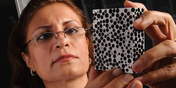 Afsaneh Rabiei examines a sample of composite metal foam. Her pioneering research has led to armor plating that weighs far less than steel and is capable of stopping armor-piercing .50-caliber bullets. Credit: North Carolina State University