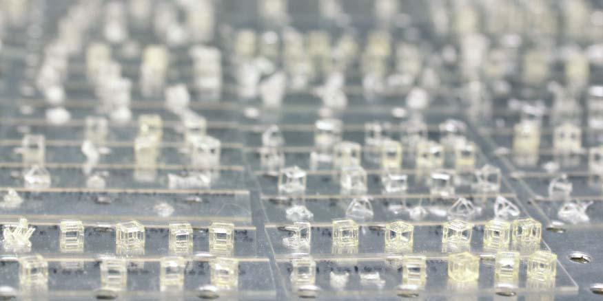 By using laser-generated, hologram-like 3-D images flashed into photosensitive resin, researchers can build complex parts in a fraction of the time of traditional layer-by-layer printing. Credit: Lawrence Livermore National Laboratory