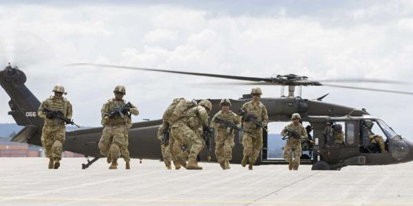 Soldiers from the 10th Mountain Division (LI) perform an air assault demonstration for President Trump during a visit to Fort Drum, New York, on August 13. The demonstration was part of the President's ceremony to sign the National Defense Authorization Act of 2019, which authorizes funding for U.S. defense and military activities for Fiscal Year 2019. Photo credit: U.S. Army photo by Sgt. Thomas Scaggs.