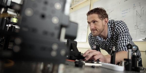 Michael Reimer, assistant professor of electrical and computer engineering at the University of Waterloo, aligns a quantum light source at the university's Institute for Quantum Computing. Work performed at the institute could lead to quantum radar capable of seeing through high-energy interference as well as detecting stealth aircraft.