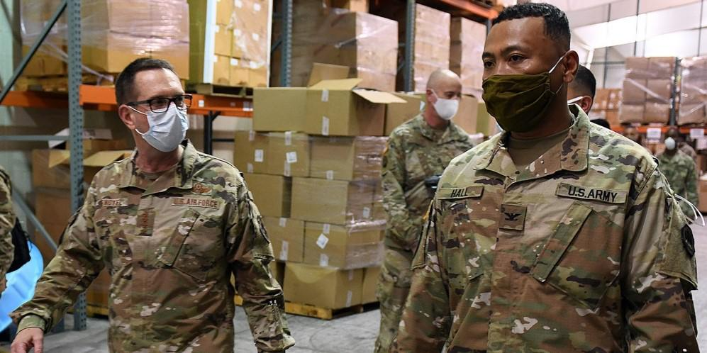 Gen. Joseph Lengyel (l), USAFG, chief of the National Guard Bureau, speaks with Col. Hall, USAG from the Louisiana National Guard during a 2020 tour of the state's Public Safety warehouse supporting the COVID-19 response in Baton Rouge. The Space Force could have a guard component, but the Defense Department needs to complete a study on the viability. Credit: U.S. Air National Guard photo by Master Sgt. Toby Valadie