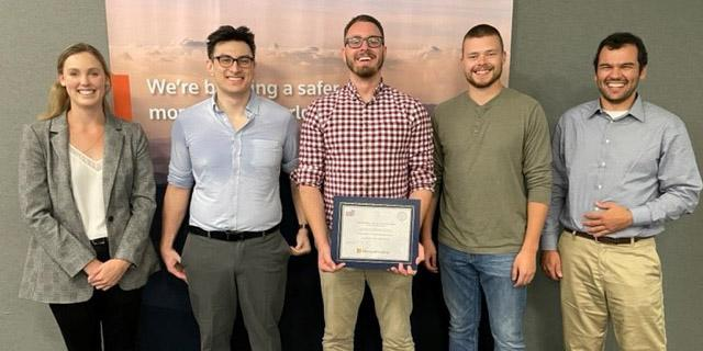 TRSS colleagues formed Team PhishRSS to enter this year's AFCEA EPIC App Challenge, creating an app that adds an element of security to social media privacy settings to win the $5,000 first place prize. Pictured from left: Hannah Lensing, Zach Seid, Zachary Drake, Chris Smith and William Garcia.