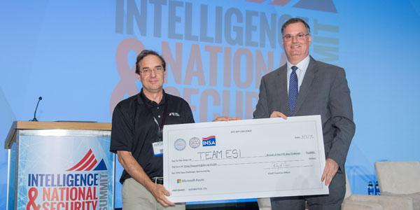 Jim Cannaliato of Engineering Solutions Inc. (l) receives a $3,000 check for his company's winning entry in the EPIC App challenge. Presenting the check is AFCEA Intelligence Committee member Joe Schmank of Microsoft Azure Government Cloud.