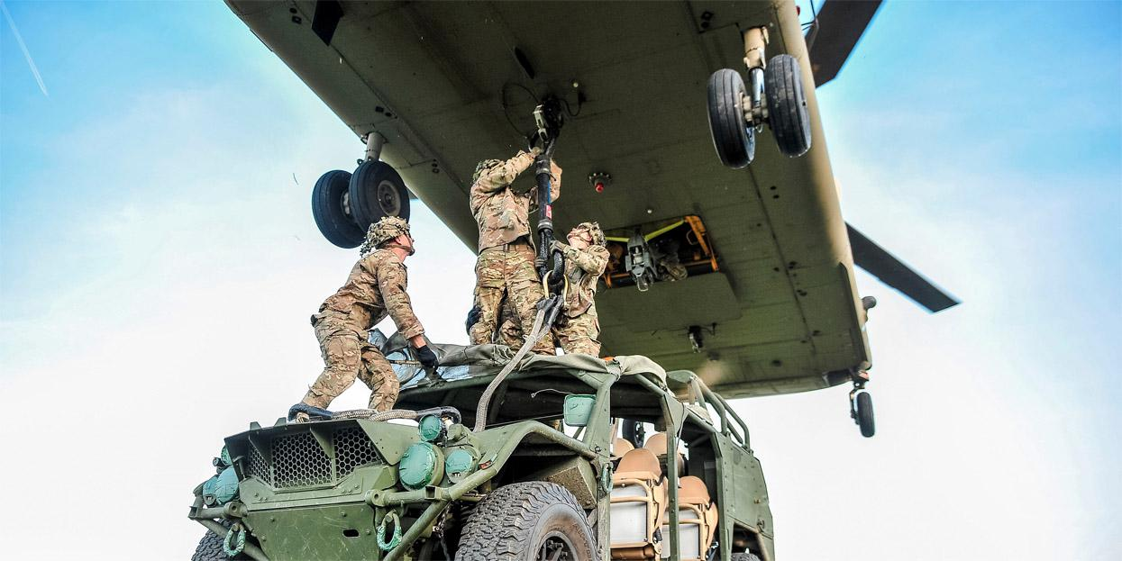 Army paratroopers sling-load a ground mobility vehicle to a CH-47 Chinook helicopter during a September 2019 Saber Junction exercise in Germany. Army officials intend to invest heavily in multidomain operations in the coming years. Credit: Army Sgt. Henry Villarama