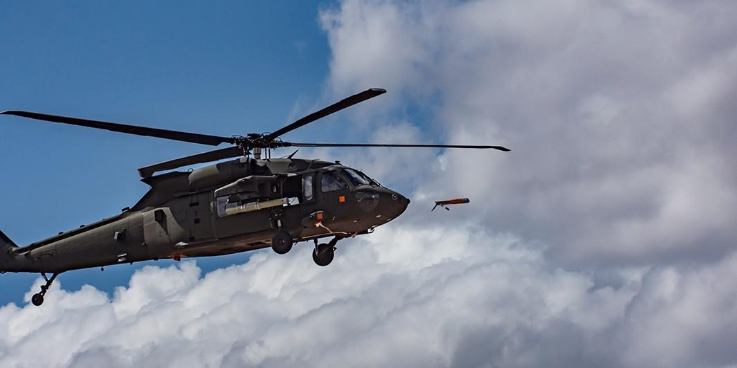 An Area-I Air-Launched, Tube-Integrated, Unmanned System, or ALTIUS, is launched from a UH-60 Black Hawk at Yuma Proving Ground, Arizona, March 4 where the U.S. Army Combat Capabilities Development Command Aviation & Missile Center led a demonstration that highlighted the forward air launch of the ALTIUS. Courtesy photo provided by Yuma Proving Ground