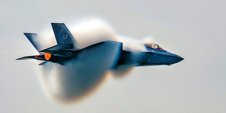 "Air Force Capt. Andrew ""Dojo"" Olson, commander of the F-35 Heritage Flight Team, performs a high-speed pass during the Canadian International Air Show in Toronto, Sept. 1, 2018. The F-35 program office intends to award rapid development contractors to small businesses to rapidly develop and deliver an array of technologies for the aircraft. Photo by Airman 1st Class Alexander Cook"