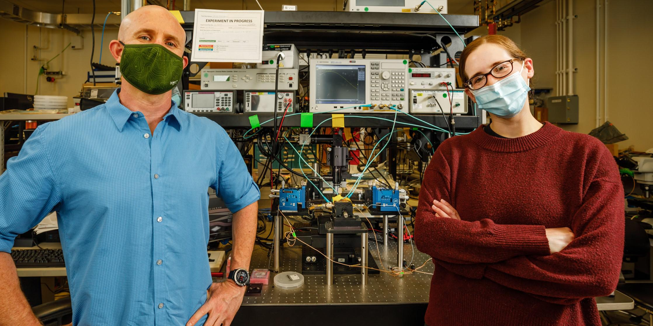 Matt Eichenfield (l) and Lisa Hackett, scientists at Sandia National Labs, recently created a groundbreaking acoustic circulator, a key radio component that separates transmitted and received signals, and is much smaller in size. Credit: Sandia National Labs/Bret Latter