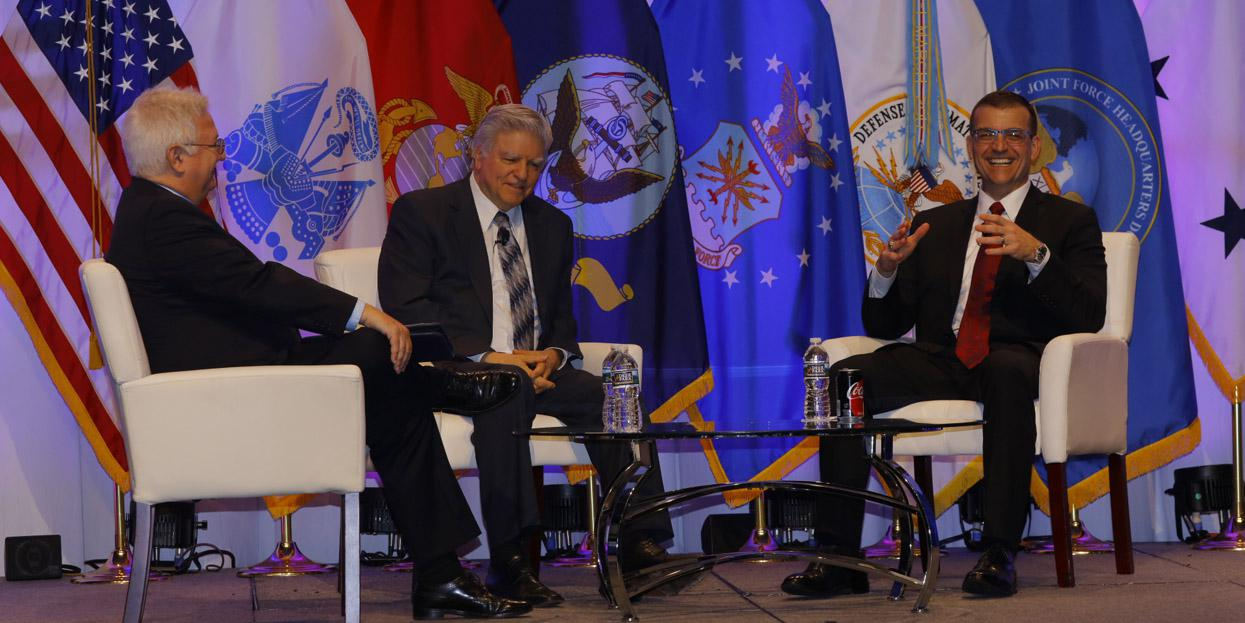 From l-r, Robert K. Ackerman, SIGNAL editor in chief, moderates a TechNet Cyber luncheon plenary with speakers Tony Montemarano, DISA executive deputy director, and Jeffrey Jones, executive director, JFHQ-DODIN. Photo by Michael Carpenter