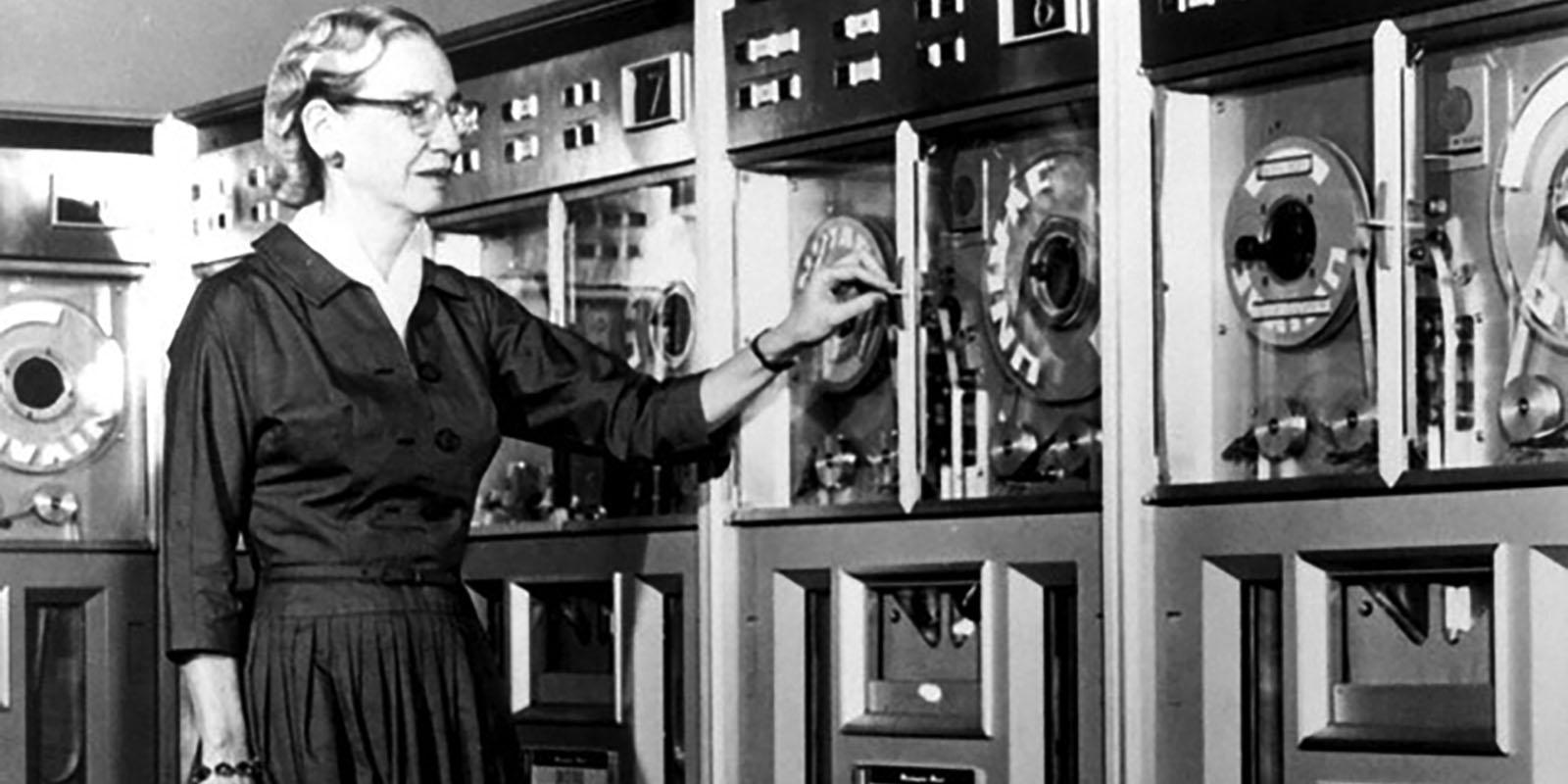 After serving in the U.S. Navy during World War II, Grace Hopper remained in the naval reserve. In 1952, her team at Remington Rand created the first compiler for computer languages, which was a precursor for COBOL. In this 1960 report, Hopper stands next to a mainframe computer that ran using COBOL. Courtesy of the Computer History Museum