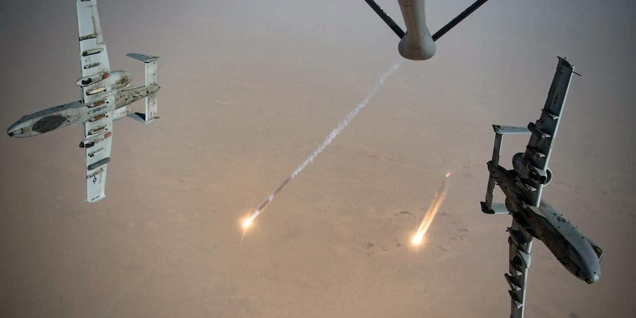 U.S. Air Force A-10 Thunderbolt II jets fire flares while breaking away after aerial refueling from a KC-135 Stratotanker of the 340th Expeditionary Aerial Refueling Squadron out of Kandahar Airfield, Afghanistan, in August. In multidomain operations in the future, the Air Force will need a highly connected web of sensors across the air, land, sea and space.  U.S. Air Force photo by Staff Sgt. Keifer Bowes