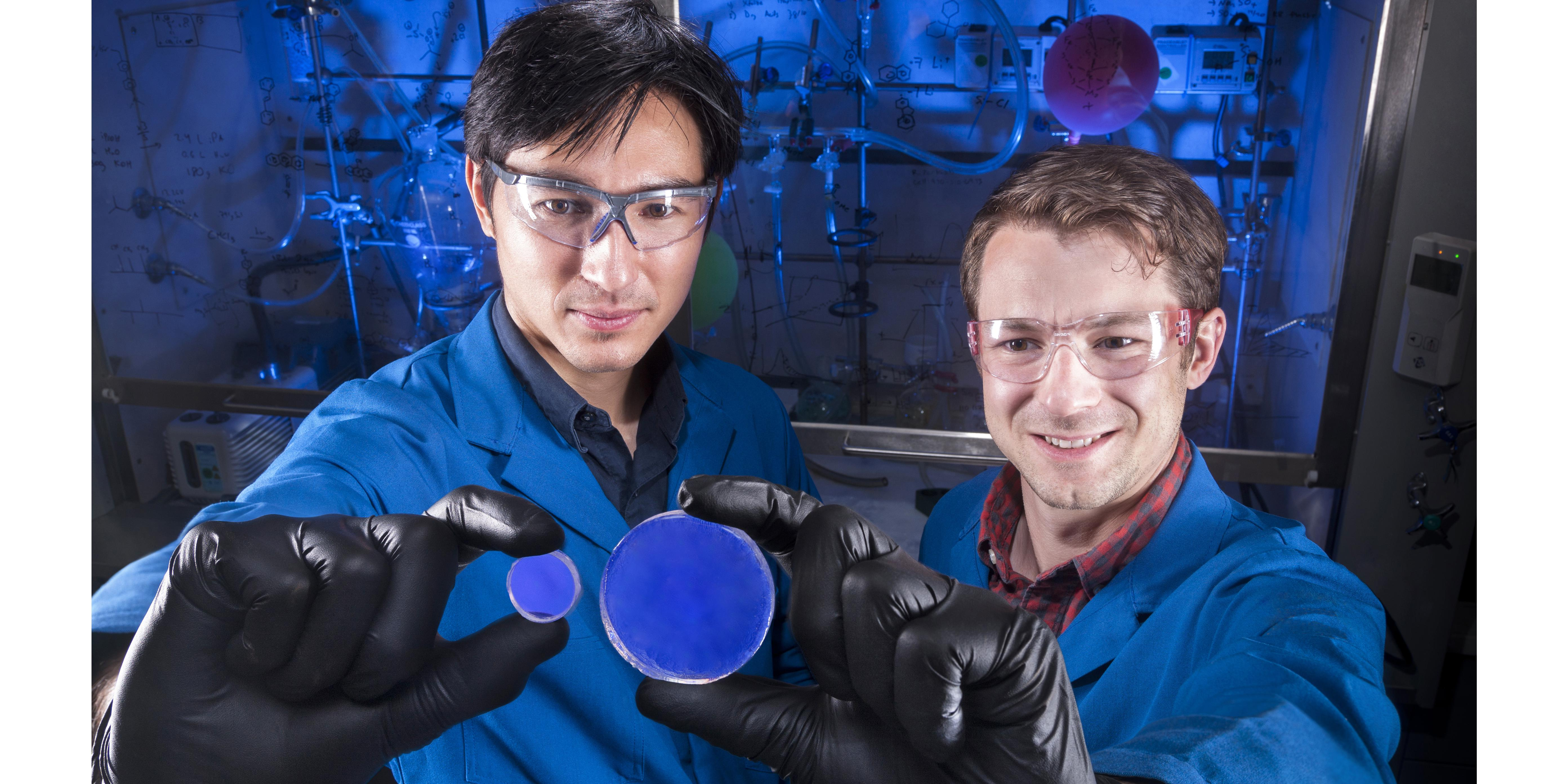 Sandia National Laboratories researcher Patrick Feng (l), holds a trans-stilbene scintillator and organic chemist Joey Carlson holds a scintillator made of organic glass.