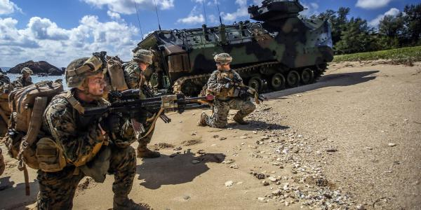 Marines exit a vehicle onto the beach during a recent amphibious landing exercise at Kin Blue Beach in Okinawa, Japan. The Marines need advanced technologies that will not limit their mobility.