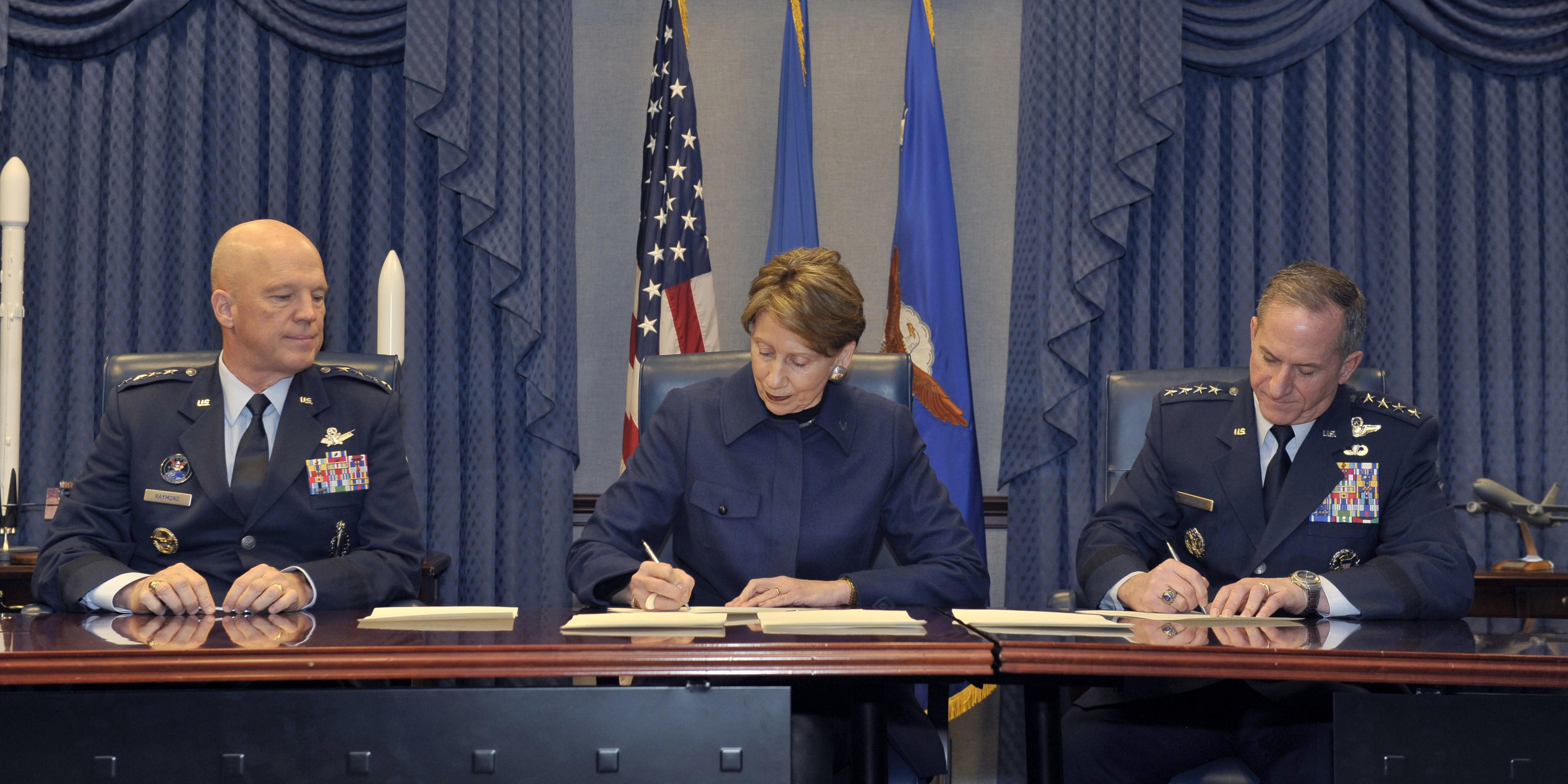 The U.S. Space Force will grow to about 16,000 warfighters, civilians and contractors. Top military leaders, including, Gen. John Raymond (l), commander of United States Space Command and Air Force Space Command; Secretary of the Air Force Barbara Barrett (c); and previous Chief of Staff of the Air Force Gen. David L. Goldfein, sign memorandums to authorize the service last December. Credit: Secretary of the Air Force Public Affairs, Photo by Tech. Sgt. Robert Barnett