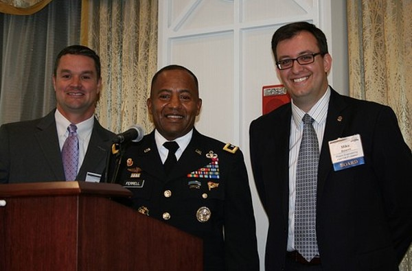 Together during the State of C4ISR event in October are (l-r) Tim Jahnigen, Maj. Gen. Robert Ferrell, USA, the commanding general of the Communications and Electronics Command, and Mike Bowen.